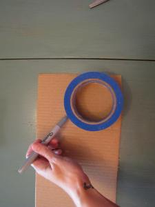Trace and cut a circle out of cardboard.