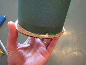 Glue your cylinder and your circle together with two layers of glue