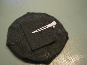 Glue down your clip if you're using one. I did this before assembling my two hat pieces.
